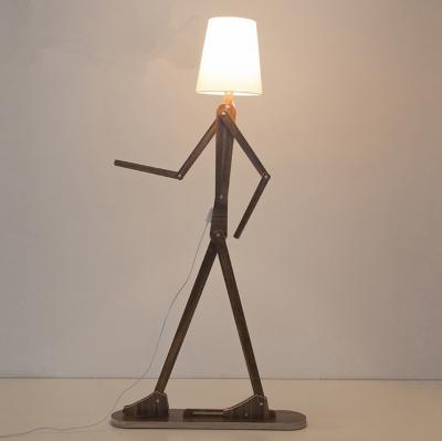 Drevená dekoračná stojacia a podlahová lampa v tvare človeka