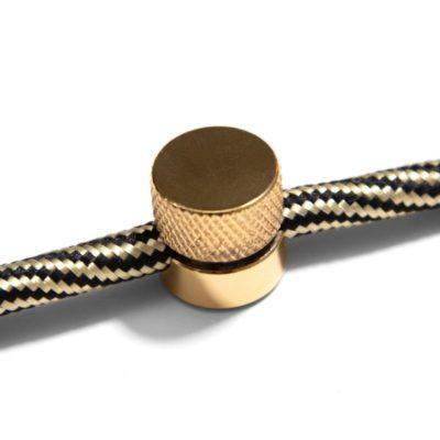 Kovová nástenná fixácia pre textilný kábel - Zlatá farba.